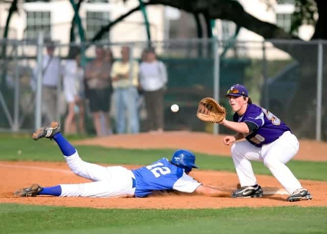 Tuition free college baseball player diving back into first base
