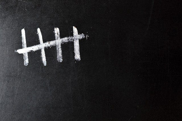 Marks on a chalkboard with the number five