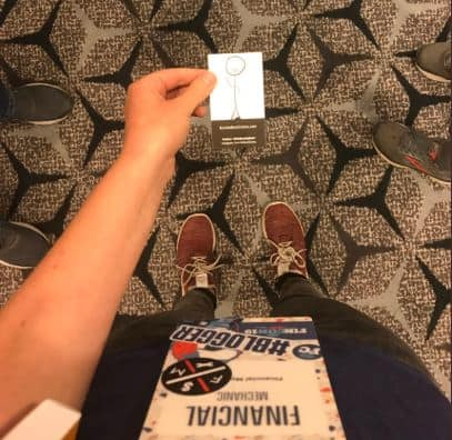 Photo of Financial Mechanic holding Mr. Burrito Bowl's business card at FinCon 2019