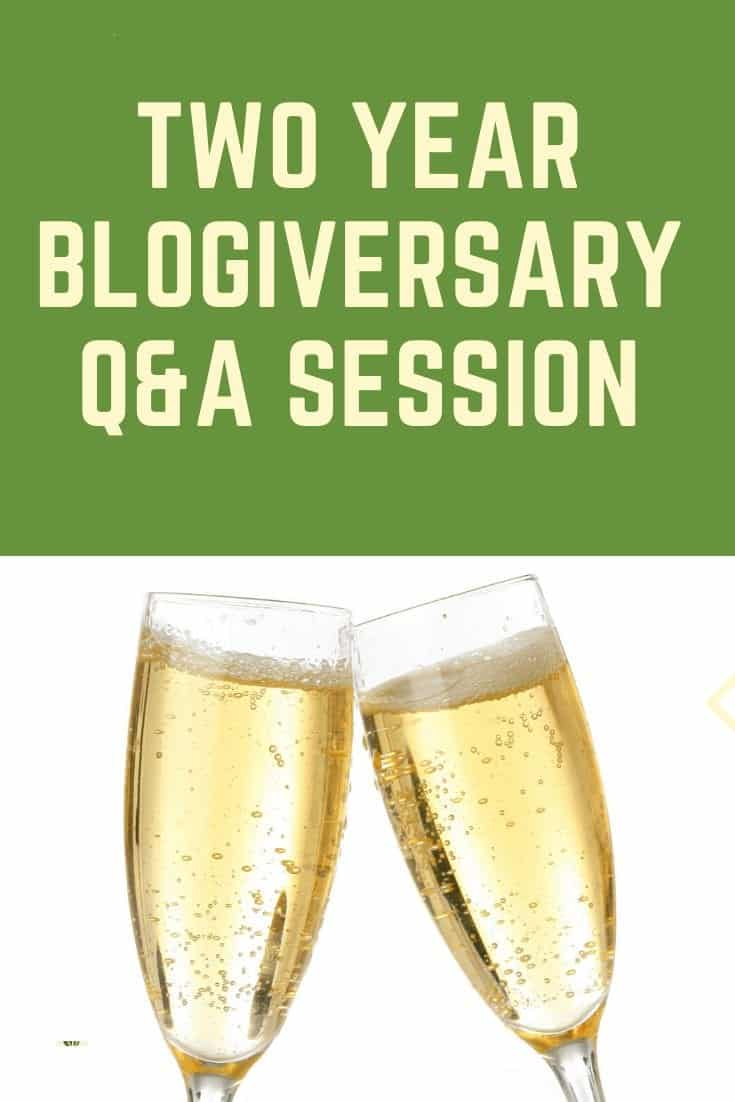 Two year blogiversary Pinterest pin with two champagne classes clanking